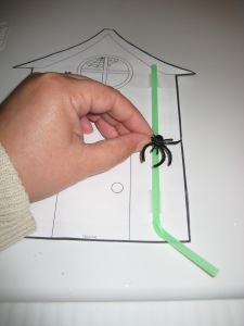 Place the spider ring on the straw, which you will later tape at the top and bottom of the straw.  Then have students act out the story and move the spider up and down the waterspout!
